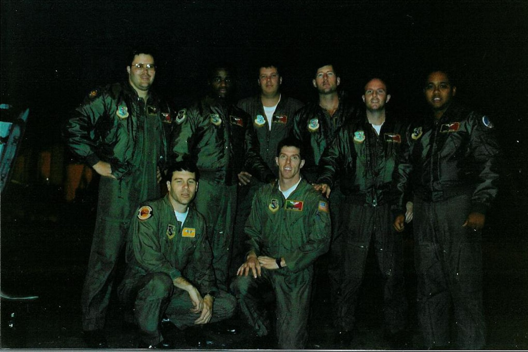 Photo of Airmen posing on runway.