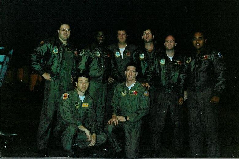Photo of Airmen posing on runway.