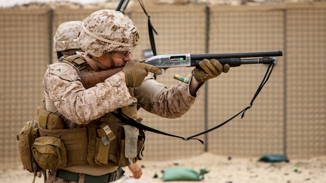 A U.S. Marine with 2nd Battalion, 7th Marines, assigned to Special Purpose Marine Air-Ground Task Force – Crisis Response – Central Command (SPMAGTF-CR-CC) 19.2, fires a Mossberg 590A1 12-gauge shotgun during a non-lethal weapons training exercise, Jan. 18, 2020. The SPMAGTF-CR-CC is a multiple force provider designed to employ ground, logistics and air capabilities throughout the Central Command area of responsibility. (U.S. Marine Corps photo by Sgt. Robert G. Gavaldon)