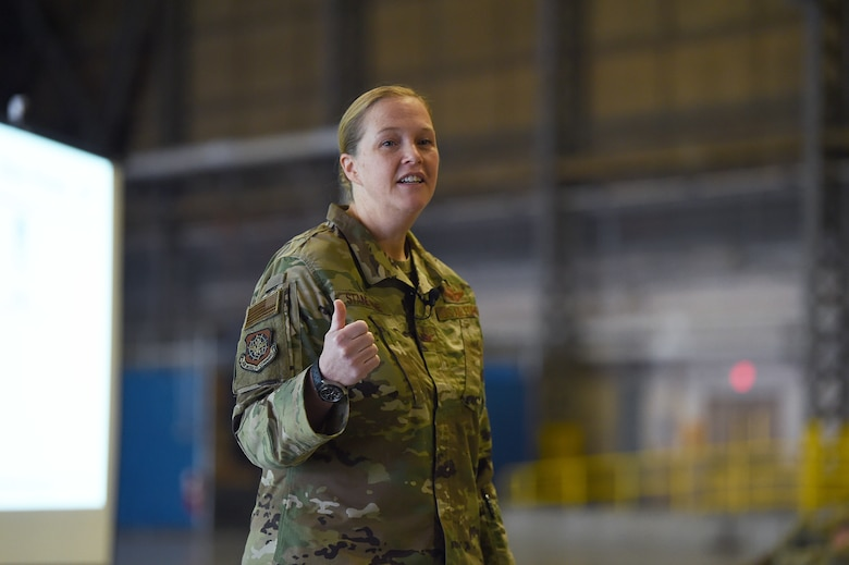 Col. Erin Staine-Pyne, 62nd Airlift Wing commander, speaks to members of the wing during a commander's call Jan. 16, 2020 at Joint Base Lewis-McChord, Wash. One of her top priorities as commander is making sure Airmen are restoring readiness to win any fight at any time. (U.S. Air Force photo by Airman 1st Class Mikayla Heineck)