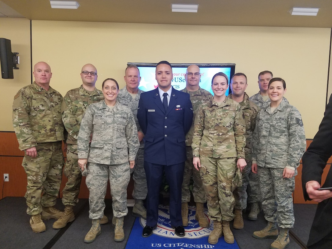 Airman David Hernandez (blue uniform), stands with members of the 132d Wing who came to watch him take the oath of allegiance as an American citizen December 20, 2019, in Des Moines, Iowa. (Courtesy Photo)