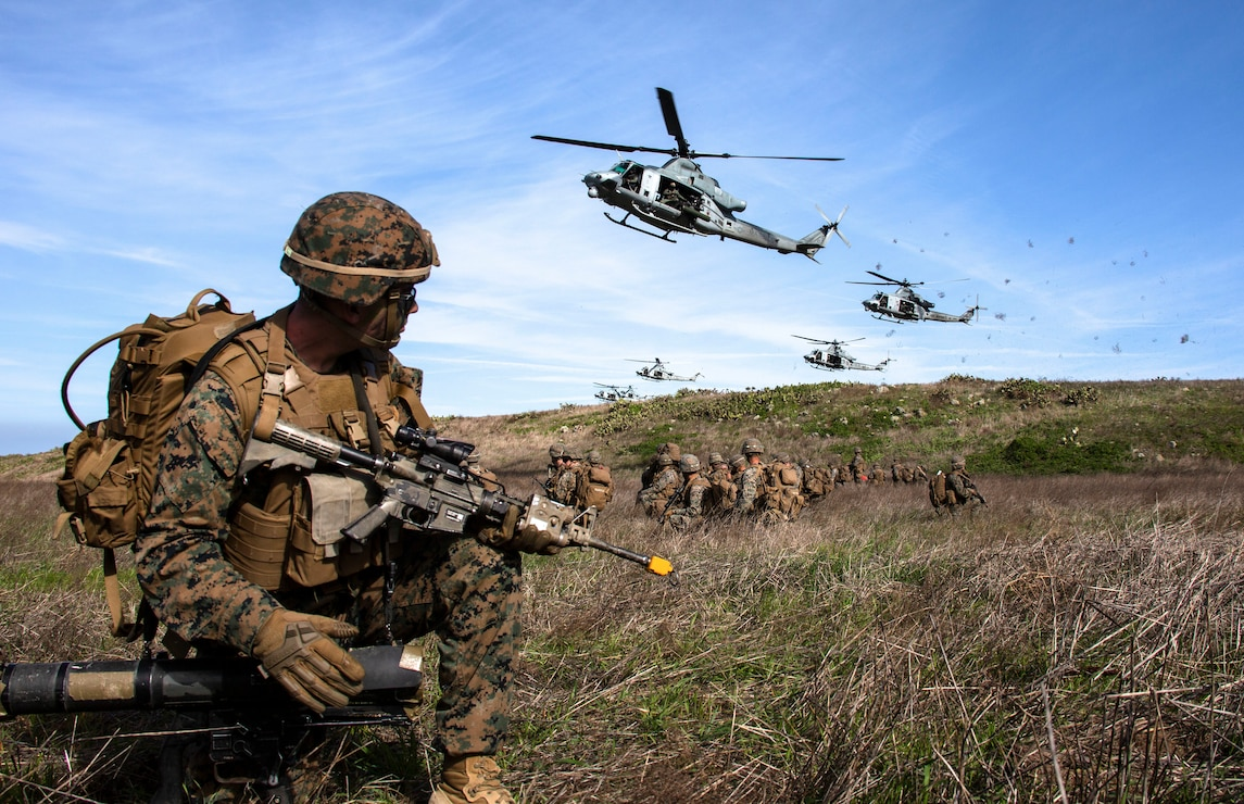 U.S. Marines provide security for UH-1Y Venoms at a landing zone during Exercise Venom Storm on San Clemente Island, Calif., Jan. 15.