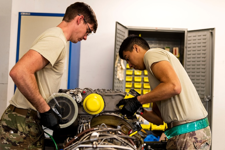 rman 1st Class Jonathan Flores, right, 41st Helicopter Maintenance Unit apprentice, and Staff Sgt. Leon Blomeley, 41st HMU craftsman, remove a gearbox during a gearbox seal replacement on a spare HH-60G Pave Hawk engine Jan. 15, 2020, at Moody Air Force Base, Georgia. These repairs are performed to increase spare-part availability of HH-60G engines. This allows the 41st HMU to swiftly return aircraft to mission-capable status without delay. (U.S. Air Force photo by Senior Airman Erick Requadt)