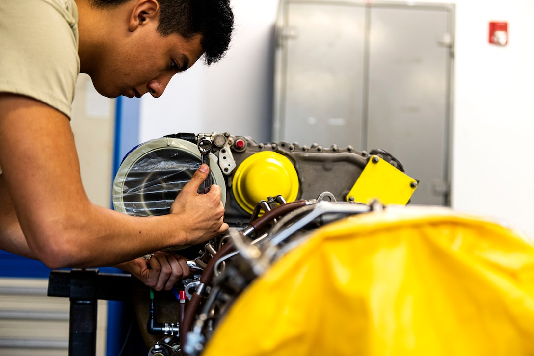 Airman 1st Class Jonathan Flores, 41st Helicopter Maintenance Unit apprentice, disconnects an oil scavenge tube during a gearbox seal replacement on a spare HH-60G Pave Hawk engine Jan. 15, 2020, at Moody Air Force Base, Georgia. These repairs are performed to increase spare-part availability of HH-60G engines. This allows the 41st HMU to swiftly return aircraft to mission-capable status without delay. (U.S. Air Force photo by Senior Airman Erick Requadt)