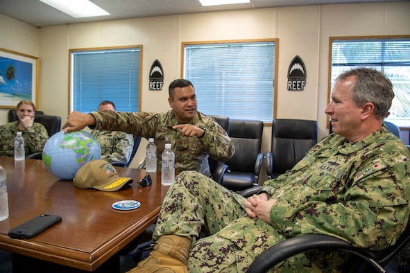 DIEGO GARCIA, British Indian Ocean Territory - Maj. Jesse Diaz, 21st Space Operations Squadron Detachment 1 commander, explains how the Air Force Satellite Control Network works to Rear Adm. Brian Fort, U.S. Naval Forces Japan and Navy Region Japan commander, at the U.S. Navy Support Facility, Diego Garcia, Jan. 15, 2020. The 21st SOPS Det. 1 is a tenant unit at NSF Diego Garcia, conducts AFSCN operations, provides launch support as augmentation to the Western Range, manages global positioning system ground infrastructure and is the lead for 24/7 AFSCN cyber security scanning. (U.S. Navy photo by Mass Communication Specialist 3rd Class Dartanon Diego Delagarza)