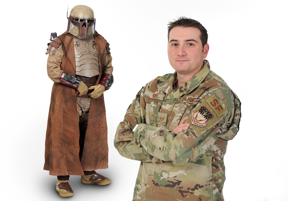 Tech. Sgt. Sean Neri, 341st Security Forces Support Squadron vehicle readiness center NCO-in charge, poses in his custom-made Mandalorian suit and in his Air Force uniform Jan. 15, 2020, at Malmstrom Air Force Base, Mont.