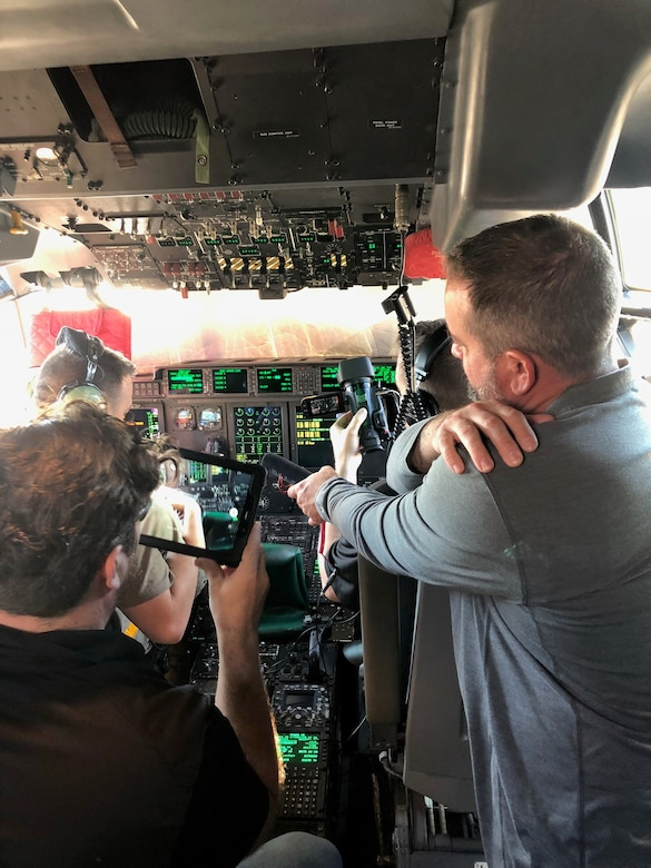 A Mass Virtual team member scan the flight deck of a C-130J Super Hercules to design a virtual reality environment to train C-130 maintainers.