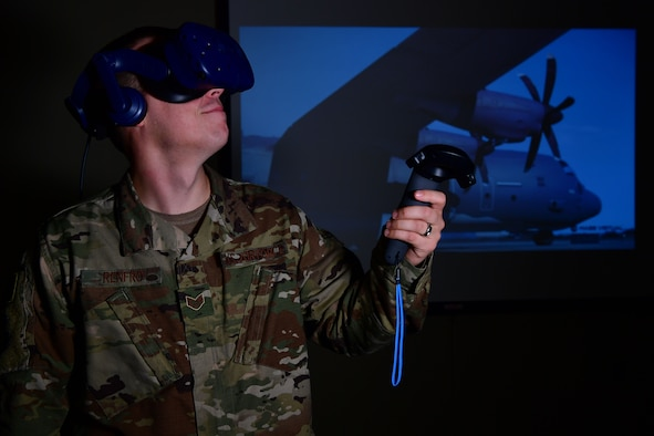 U.S. Air Force Staff Sgt. Kenneth Renfrow, 19th Maintenance Group maintenance qualifications training instructor, uses a virtual reality headset