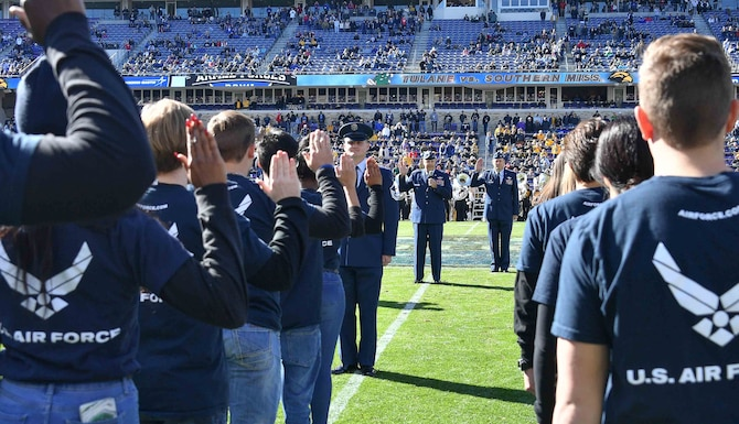 Tenth Air Force Commander Maj. Gen. Brian Borgen administers the oath of enlistment to 125 recruits during halftime at the Lockheed Martin Armed Forces Bowl on January 4, 2020 at Amon G. Carter Stadium in Fort Worth, Texas. The United States Army, Marines, Navy, Air Force and Coast Guard were represented by providing 25 recruits each who will join Active Duty, the National Guard and the Reserve. (U.S. Air Force photo by Jeremy Roman)