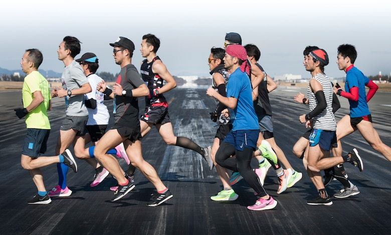 Athletes in a Half Marathon cross the runway during the 39th Annual Frostbite Run, Jan.19, 2020, at Yokota Air Base, Japan.