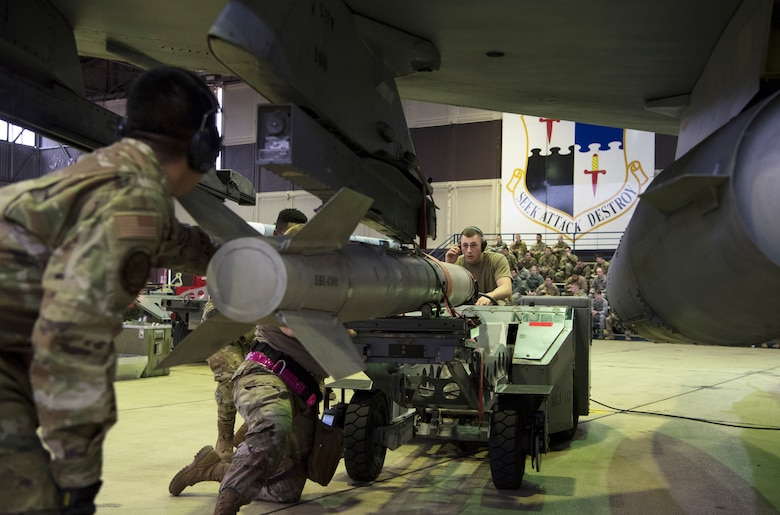 The competition required two teams of three Airmen to load weapons onto the wings of an F-16 Fighting Falcon as quickly and accurately as possible