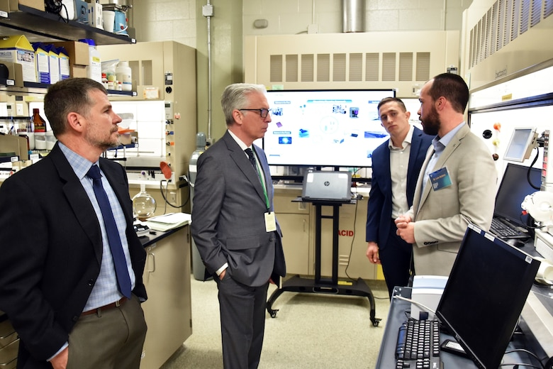 Ohio State University futurist, Dr. David Staley, talks with researchers in the Air Force Research Laboratory chemistry foundry lab. Pictured from left to right are Dr. Russell Kurtz, Dr. David Staley, Dr. Luke Baldwin and Jordan Kaiser. (U.S. Air Force photo/Spencer Deer)