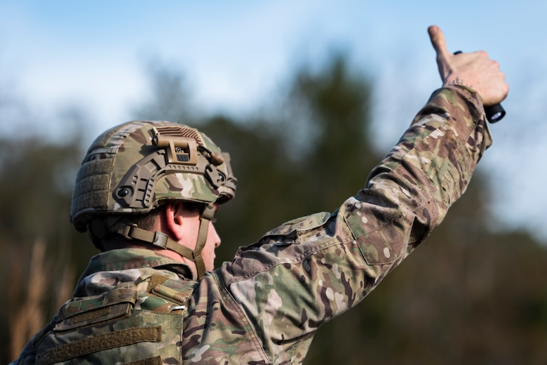 A photo of an Airman giving a hand signal