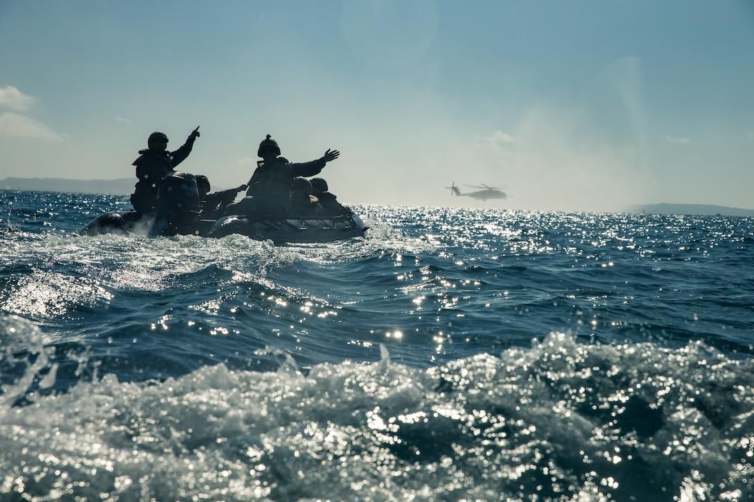 Marines move into position to begin a simulated beach raid at Kin Blue, Okinawa, Japan, Dec. 17.