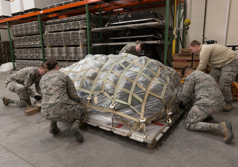 U.S. Air Force Airmen, assigned to the Logistics Readiness Squadron at the 103rd Airlift Wing, Connecticut Air National Guard, secure a pallet at Bradley Air National Guard Base, East Granby, Conn., Jan. 5, 2020. The 103rd AW conducted a base-wide deployment exercise to enhance Airmen's readiness for rapid mobility. (U.S. Air National Guard photo by Airman 1st Class Chanhda Ly)
