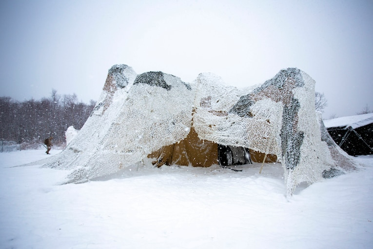 A military shelter in the snow.