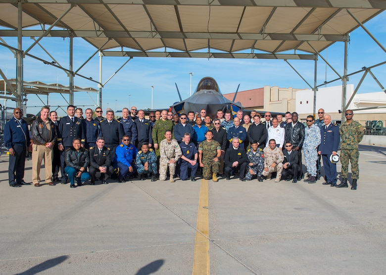 Students and staff from the Naval Command College pose with an F-35A Lightning II, Jan. 14, 2020, at Luke Air Force Base, Ariz.
