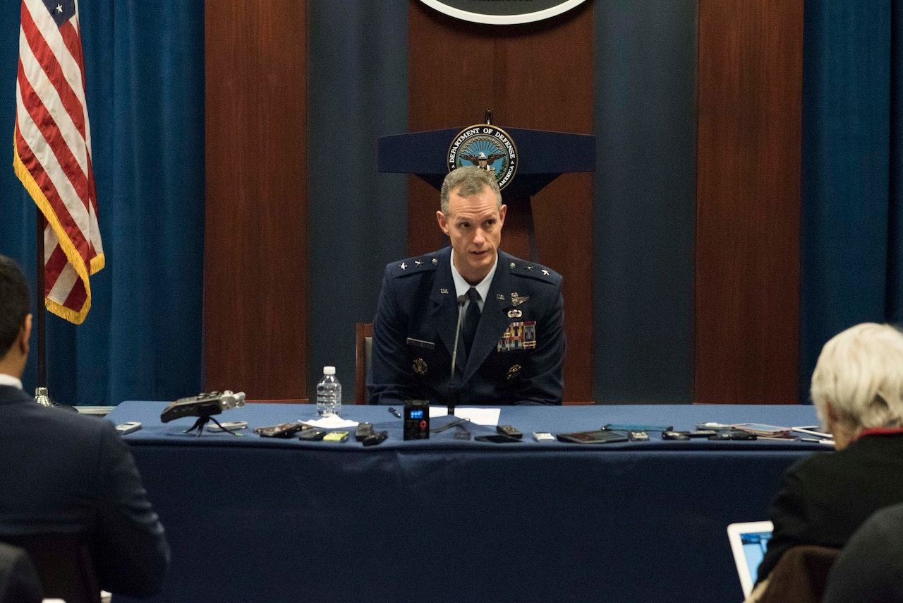 A major general speaks to reporters.