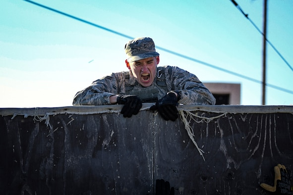 A 51st Security Forces Squadron defender performs a wall climb during a physical training challenge as part of a Combat Readiness Course, Dec. 12, 2019, at Osan Air Base, Republic of Korea. The course challenges Osan's newest defenders on their readiness and skills to defend the base. (U.S. Air Force photo by Staff Sgt. Greg Nash)