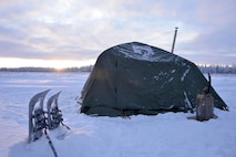 A cold-weather tent sits in subzero temperatures in the Husky Drop Zone at Eielson Air Force Base, Alaska, Jan. 15, 2020. Tactical air control party Airmen from Detachment 1, 3rd Air Support Operations Squadron, set up temporary lodging during a three-day field training event held from Jan. 14-16. (U.S. Air Force photo by Capt. Kay Magdalena Nissen)