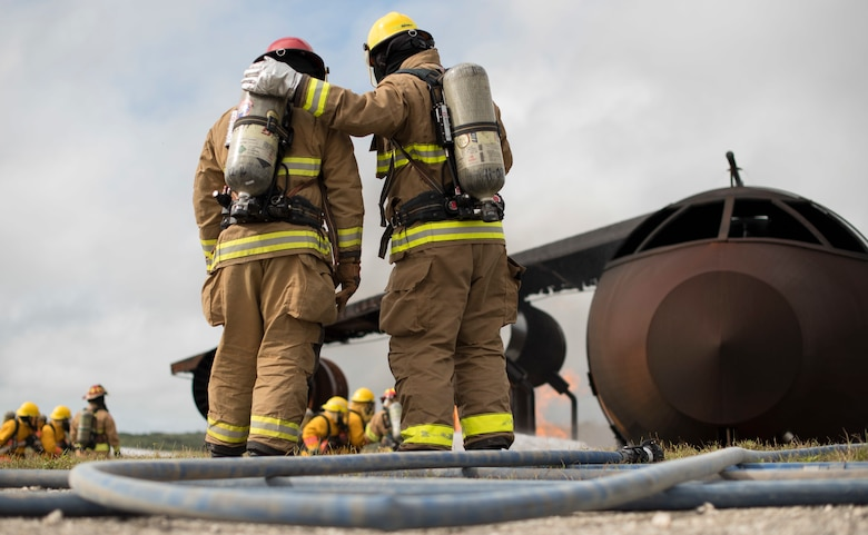 Firefighters from the Pacific Region participate in a live fire training burn, January 8, 2020, at Andersen Air Force Base, Guam.