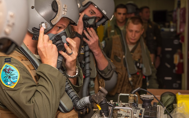 69th Expeditionary Bomb Squadron pilots, check equipment functionality before a flight at Andersen Air Force Base, Guam, Jan. 16, 2020.