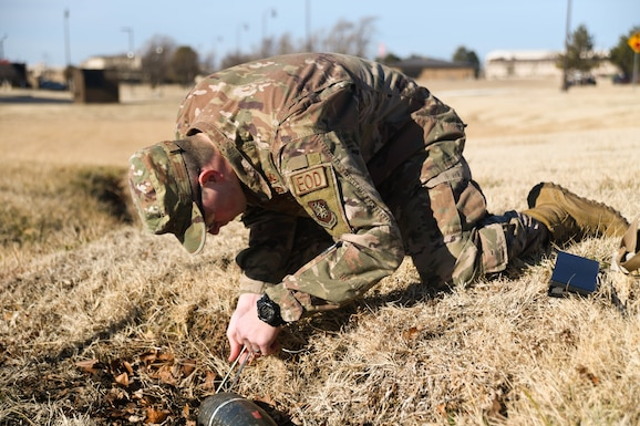 Staff Sgt. Kaanen Brabbs, 22nd Civil Engineering Squadron explosive ordnance technician, measures an unidentified explosive ordnance during upgrade training Jan. 9, 2020, at McConnell Air Force Base, Kansas.  McConnell's EOD flight is responsible for providing rapid response capabilities to nine core mission areas. (U.S. Air Force photo by Airman 1st Class Nilsa E. Garcia)