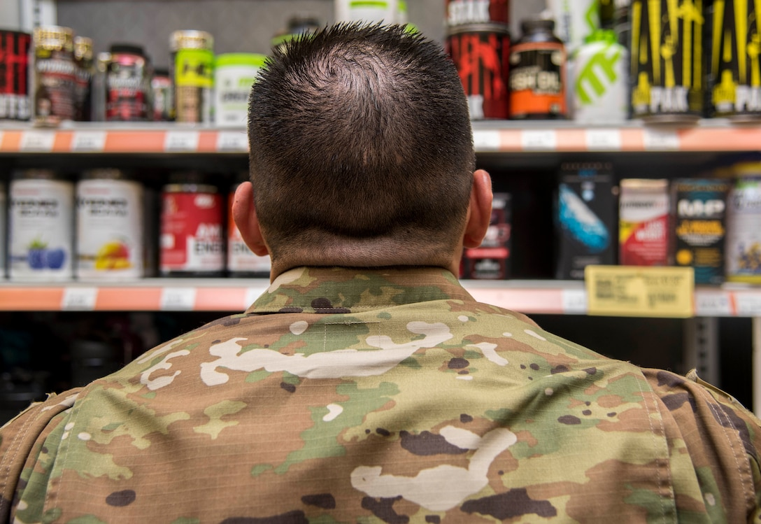 An Airman from Dover Air Force Base, Del., shops for supplements January 15, 2020. There are no Food and Drug Administration regulations in place for CBD products and there is no mandated oversight or quality control for these products. Service members should know what products they are ingesting. (U.S. Air Force photo by Staff Sgt. Nicole Leidholm)