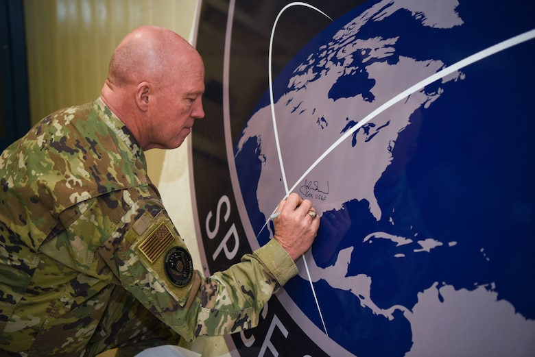 General John Raymond, U.S. Space Force chief of space operations, signs the United States Space Command sign inside of the Perimeter Acquisition Radar building Jan. 10, 2020, on Cavalier Air Force Station, North Dakota. Raymond toured inside the PAR building, where he learned first-hand how operations work inside the facility and listened to Airmen's suggestions. (U.S. Air Force photo by Senior Airman Melody Howley)