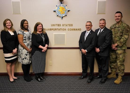 USTRANSCOM's Protocol staff pictured left to right: Liz Wszalek, Lynn Barron, Kris Byrnside, Sergio Gonzalez, Pete Wiederholt, and U.S. Air Force Senior Master Sgt. Jerid Stephenson.