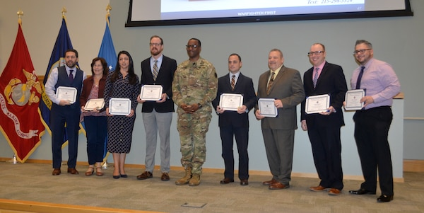 DLA Troop Support employees receive awards.