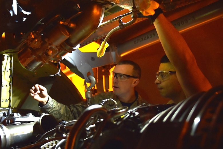Master Sgt. Nathan Foxworth, 434th Maintenance Squadron propulsion flight chief, instructs Senior Airman Jesse Medrano 434th MXS propulsion specialist, as they prepare to install an engine in the wing of a KC-135R Stratotanker at Grissom Air Reserve Base, Indiana, Jan. 11, 2020. The 6,000 pound engine replaced another engine that showed signs of over temping and decreased performance. (U.S. Air Force photo/Tech. Sgt. Jami Lancette)