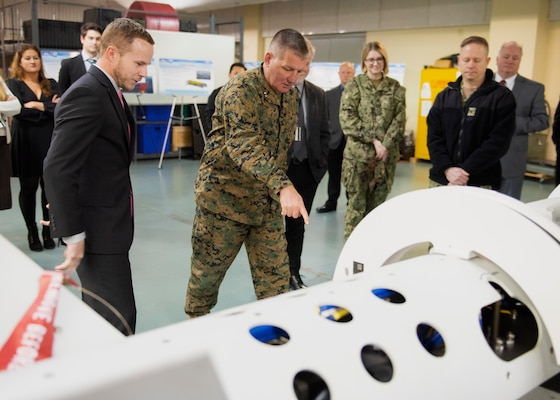 Jarred Kinder, engineer at Naval Surface Warfare Center Panama City Division, discusses mine countermeasures technology with Maj. Gen Tracy W. King, Director of Expeditionary Warfare (OPNAV N95) during a familiarization tour January 22.