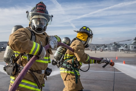 ARFF conducting handline drills on Marine Corps Air Station Camp Pendleton