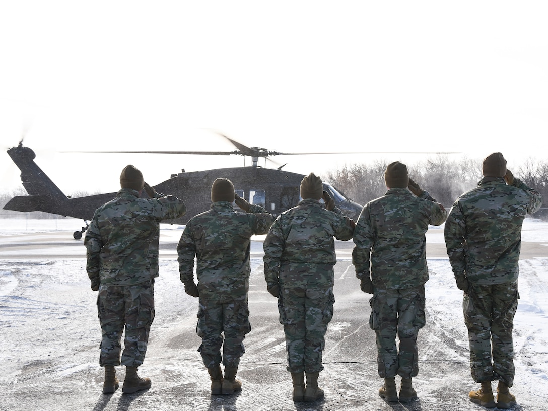 Base leaders greet General John Raymond, U.S. Space Force chief of space operations, on their helicopter pad Jan. 10, 2020, on Cavalier Air Force Station, North Dakota. Raymond arrived to Cavalier after visiting the University of North Dakota, where he toured the new Walking Space Studies facility and spoke with Reserve Officer Training Corps and Space Studies students. (U.S. Air Force photo by Senior Airman Melody Howley)