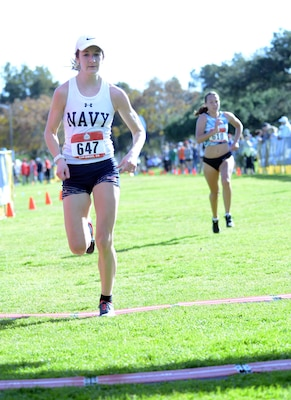 Navy Lt. j.g. Rachel Viger of the Naval Operations Support Center Washington, D.C., crosses the finish line at 39:49 to finish third in the Armed Forces Cross Country Championship at Mission Bay Park in San Diego, Jan. 18, 2020.