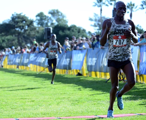 Army Sgt. Emmanuel Bor crosses the finish line of the Armed Forces Cross Country Championship at Mission Bay Park in San Diego, Jan. 18, 2020 to take second place with a time of 30:58. The race was run concurrently with the USA Track and Field senior men 10K and Bor took silver in both for the second consecutive year.