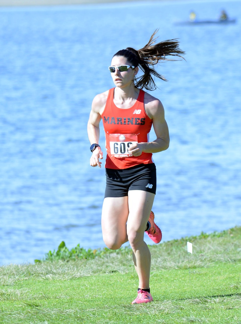 Marine Corps Capt. Lindsay Carrick of Quantico, Va., runs the second lap of the women's Armed Forces Cross Country Championship at Mission Bay Park in San Diego, Jan. 18, 2020. She took gold with a time of 38:10.