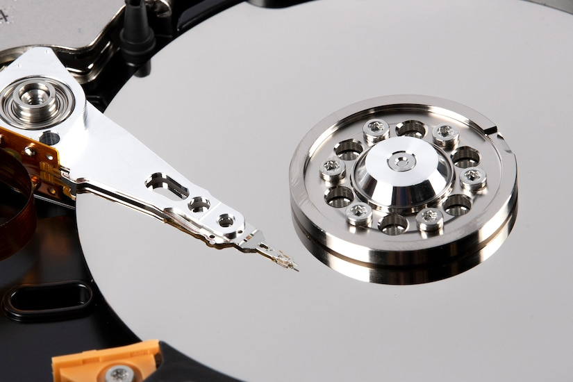 The heads of a hard drive rest over its platters.