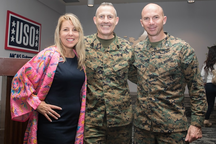 From left to right, Cindy Kirkman, area programs manager of the United Service Organizations (USO) on Marine Corps Air Station (MCAS) Futenma, Sgt. Maj. Jason L. Kappen, sergeant major of MCAS Futenma, and Col. David M. Steele, commanding officer of MCAS Futenma, pose for photo during a ceremony at the MCAS Futenma USO, Okinawa, Japan, Jan. 16, 2020. The USO on Futenma held the event to announce the grand re-opening of its center. (U.S. Marine Corps photo by Cpl. Kayla V. Staten)