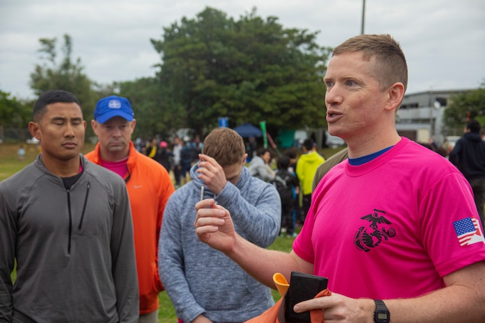 U.S. Navy Lt. j. g. Brian Bort, a chaplain assigned to Marine Corps Air Station (MCAS) Futenma, gives remarks before the 43rd Annual Ginowan Safety Relay starts at MCAS Futenma, Okinawa, Japan, Jan. 18, 2020. The relay race was held to raise awareness for road safety and to build the relationship between the U.S. military and local Okinawa communities. (U.S. Marine Corps photo by Lance Cpl. Zachary R. Larsen)