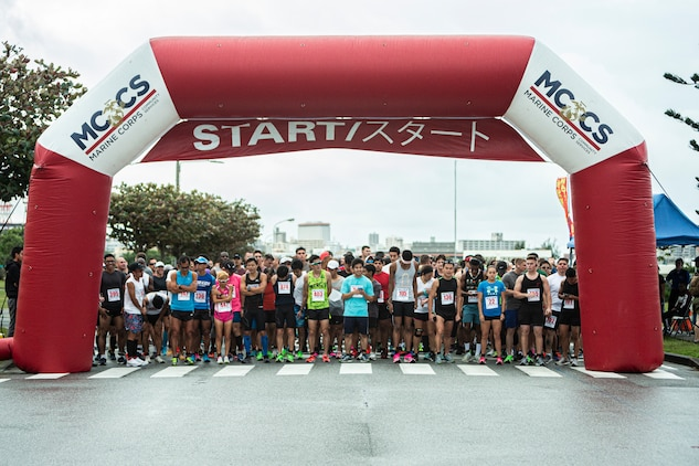 Participants in the Kinser Half-Marathon wait for the start of the event on Jan. 12, 2020 at Camp Kinser, Okinawa, Japan.