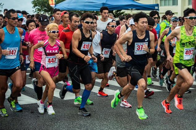 Participants begin their 13.1-mile journey in the Kinser Half-Marathon Jan. 12, 2020 at Camp Kinser, Okinawa, Japan.