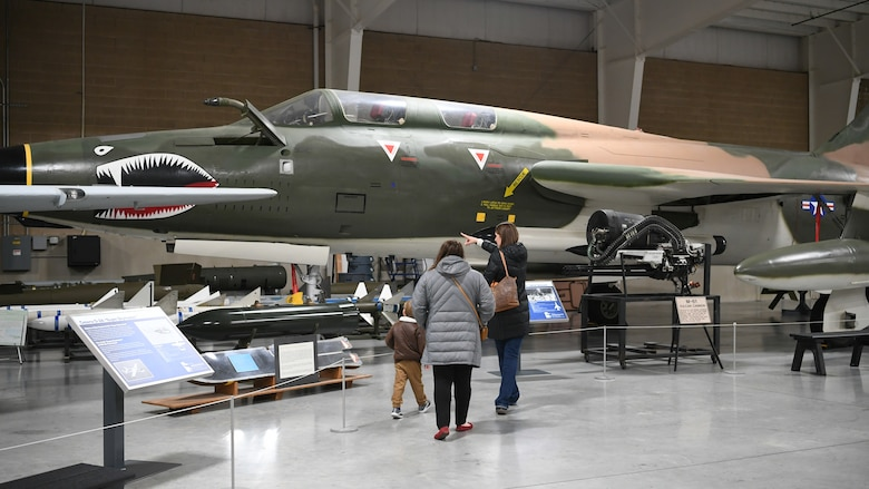 Visitors stop by the Hill Aerospace Museum's Cessna O-2A static Dec. 20, 2019, at Hill Air Force Base, Utah. The museum recently celebrated its 5 millionth visitor in November 2019.  (U.S. Air Force photo by Cynthia Griggs)
