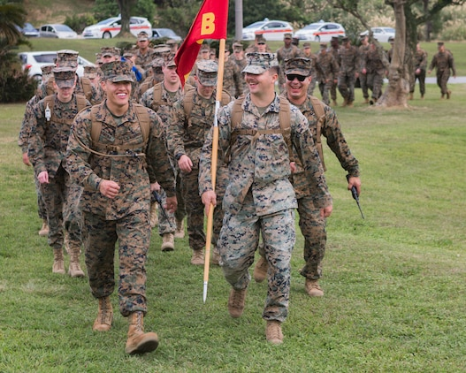 U.S. Marines and sailors assigned to Headquarters and Support Battalion, Marine Corps Installations Pacific, participate in a hike in honor of Martin Luther King Jr. around Camp Foster, Okinawa, Japan on Jan. 16, 2019.