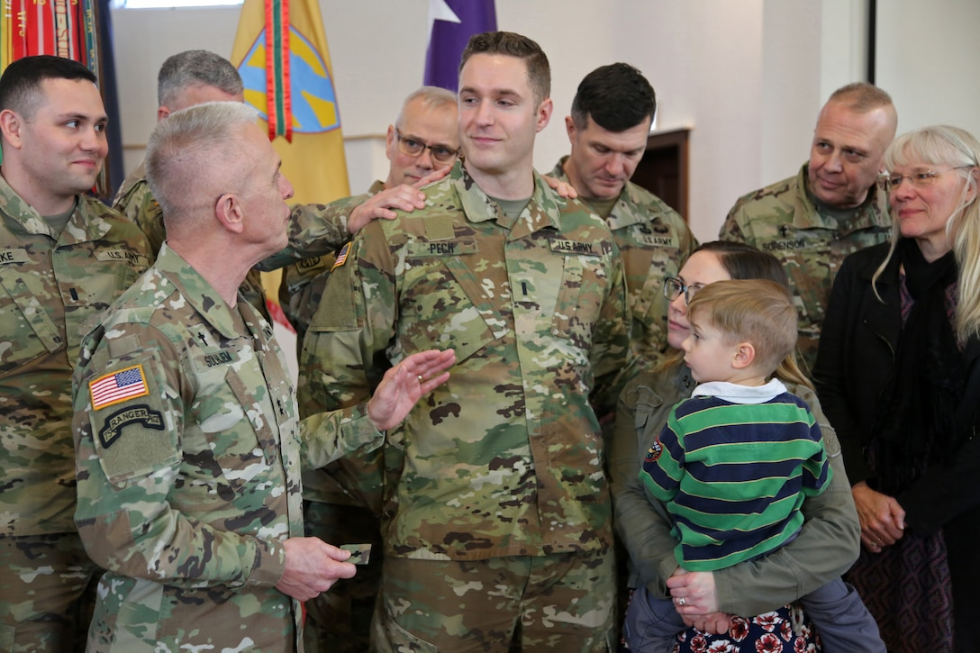 U.S. Army Chief of Chaplains, Chaplain (Maj. Gen.) Thomas L. Solhjem, speaks to newly appointed U.S. Army Reserve Chaplain (1st Lt.) Gabriel Pech, 7th Mission Support Command, before he receives the Army Chaplain cross during a pinning ceremony held at the Daenner Kaserne Chapel in Kaiserslautern, Germany on January 22, 2020. Pech was the first U.S. Army Reserve officer to complete the Chaplain Candidate Program in Europe.