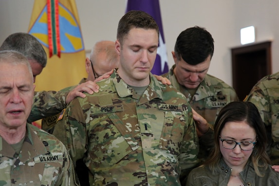 U.S. Army Chief of Chaplains, Chaplain (Maj. Gen.) Thomas L. Solhjem, leads a prayer for newly appointed U.S. Army Reserve Chaplain (1st Lt.) Gabriel Pech, 7th Mission Support Command, before he receives the Army Chaplain cross during a pinning ceremony held at the Daenner Kaserne Chapel in Kaiserslautern, Germany on January 22, 2020. Pech was the first U.S. Army Reserve officer to complete the Chaplain Candidate Program in Europe.