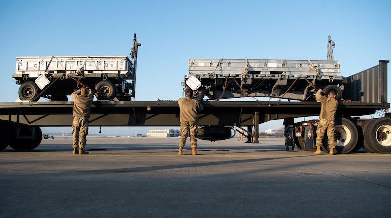 U.S. Air Force Airmen from the 52nd Logistics Readiness Squadron unload a trailer on the flightline at Ramstein Air Base, Germany, Jan. 22, 2020. 52nd Fighter Wing Airmen forward deployed from Spangdahlem Air Base, Germany, to conduct an Agile Combat Employment exercise. The wing plans to conduct ACE exercises at other locations in the future to generate aircraft in any environment and deter aggressors. (U.S. Air Force photo by Airman 1st Class Valerie Seelye)