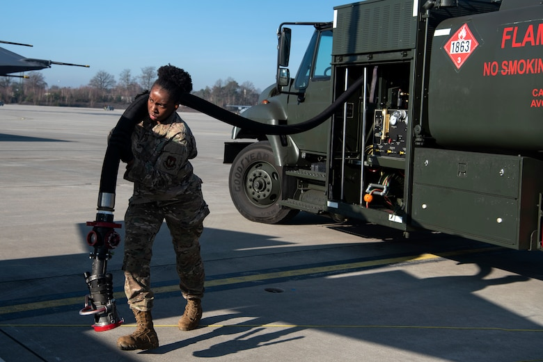 U.S. Air Force Senior Airman Aaliyah Tucker, 52nd Logistics Readiness Squadron fuels facilities operator, carries a fuel hose on the flightline at Ramstein Air Base, Germany, Jan. 22, 2020. Tucker participated in an Agile Combat Employment exercise to ensure wing readiness and deter aggressors. A small team of 52nd Fighter Wing Airmen shipped cargo, loaded munitions, and refueled F-16 Fighting Falcons while participating in the exercise. (U.S. Air Force photo by Airman 1st Class Valerie Seelye)