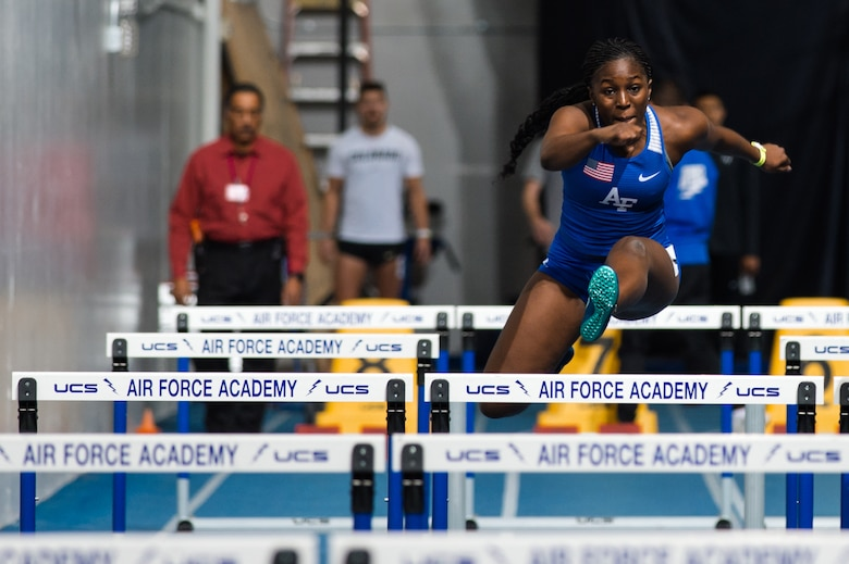 U.S. Air Force Academy cadet, leaps over a hurdle during her 60m hurdle race